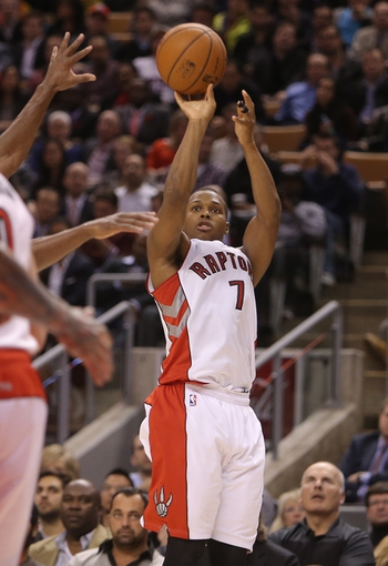 Nov 5, 2013; Toronto, Ontario, CAN; Toronto Raptors point guard Kyle Lowry (7) shoots against the Miami Heat at Air Canada Centre. The Heat beat the Raptors 104-95. Mandatory Credit: Tom Szczerbowski-USA TODAY Sports