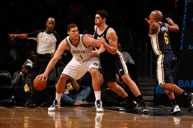 Nov 5, 2013; Brooklyn, NY, USA;   Brooklyn Nets center Brook Lopez (11) drives against Utah Jazz center Enes Kanter (0) during the third quarter at Barclays Center. Nets won 104-88.  Mandatory Credit: Anthony Gruppuso-USA TODAY Sports