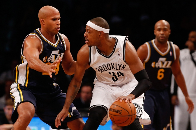Nov 5, 2013; Brooklyn, NY, USA;   Brooklyn Nets small forward Paul Pierce (34) looks to drive past Utah Jazz small forward Richard Jefferson (24) during the third quarter at Barclays Center. Nets won 104-88.  Mandatory Credit: Anthony Gruppuso-USA TODAY Sports