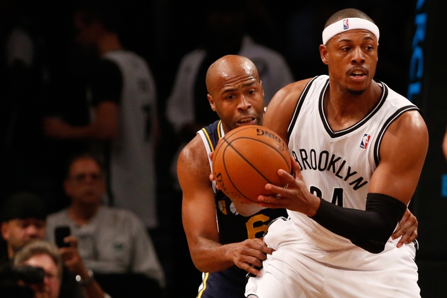 Nov 5, 2013; Brooklyn, NY, USA;  Utah Jazz point guard Jamaal Tinsley (6) holds Brooklyn Nets small forward Paul Pierce (34) during the third quarter at Barclays Center. Nets won 104-88.  Mandatory Credit: Anthony Gruppuso-USA TODAY Sports