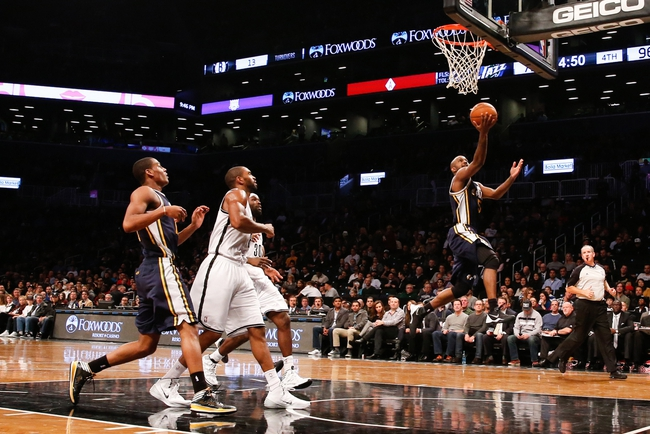 Nov 5, 2013; Brooklyn, NY, USA;  Utah Jazz point guard John Lucas III (5) drives up to the net during the third quarter against the Brooklyn Nets at Barclays Center. Nets won 104-88.  Mandatory Credit: Anthony Gruppuso-USA TODAY Sports
