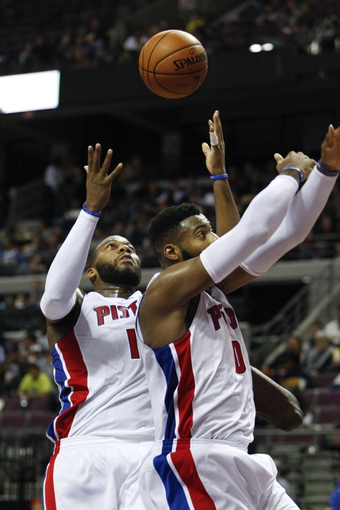 Nov 5, 2013; Auburn Hills, MI, USA; Detroit Pistons center Greg Monroe (10) grabs a rebound during the third quarter against the Indiana Pacers at The Palace of Auburn Hills. The Pacers beat the Pistons 99-91. Mandatory Credit: Raj Mehta-USA TODAY Sports