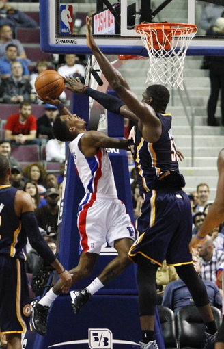 Nov 5, 2013; Auburn Hills, MI, USA; Detroit Pistons point guard Brandon Jennings (7) is defended by Indiana Pacers center Roy Hibbert (55) during the third quarter at The Palace of Auburn Hills. The Pacers beat the Pistons 99-91. Mandatory Credit: Raj Mehta-USA TODAY Sports