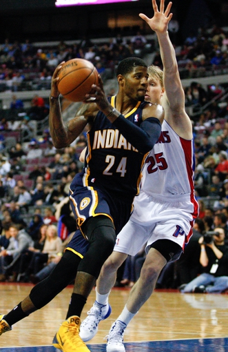 Nov 5, 2013; Auburn Hills, MI, USA; Indiana Pacers small forward Paul George (24) drives to the hole against Detroit Pistons small forward Kyle Singler (25) during the third quarter at The Palace of Auburn Hills. The Pacers beat the Pistons 99-91. Mandatory Credit: Raj Mehta-USA TODAY Sports