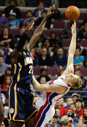 Nov 5, 2013; Auburn Hills, MI, USA; Detroit Pistons small forward Kyle Singler (25) gets fouled by Indiana Pacers center Ian Mahinmi (28) during the third quarter at The Palace of Auburn Hills. The Pacers beat the Pistons 99-91. Mandatory Credit: Raj Mehta-USA TODAY Sports