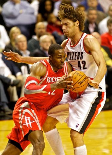 Nov 5, 2013; Portland, OR, USA; Houston Rockets center Dwight Howard (12) runs into Portland Trail Blazers center Robin Lopez (42) at the Moda Center. Mandatory Credit: Craig Mitchelldyer-USA TODAY Sports