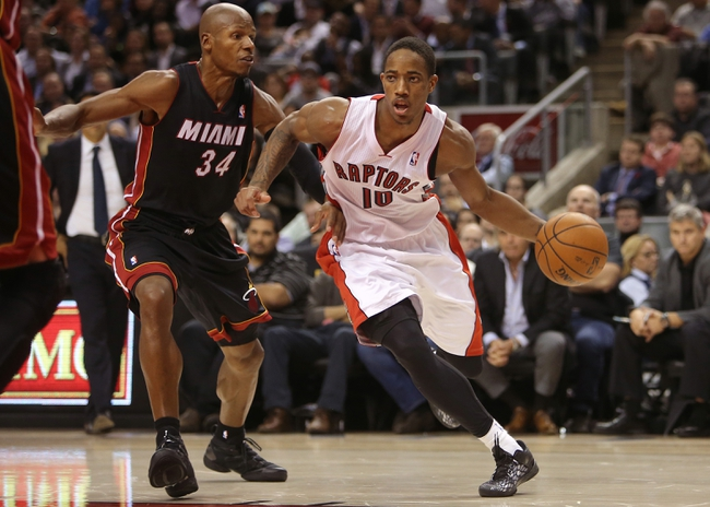 Nov 5, 2013; Toronto, Ontario, CAN; Toronto Raptors guard DeMar DeRozan (10) drives to the basket against Miami Heat guard Ray Allen (34) at Air Canada Centre. The Heat beat the Raptors 104-95. Mandatory Credit: Tom Szczerbowski-USA TODAY Sports