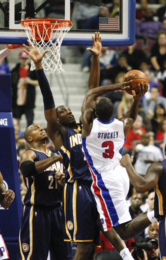 Nov 5, 2013; Auburn Hills, MI, USA; Detroit Pistons shooting guard Rodney Stuckey (3) attempts a shot over Indiana Pacers center Ian Mahinmi (28) during the third quarter at The Palace of Auburn Hills. The Pacers beat the Pistons 99-91. Mandatory Credit: Raj Mehta-USA TODAY Sports