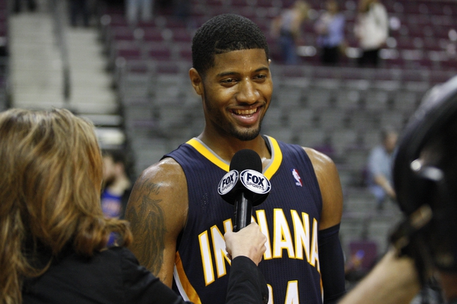 Nov 5, 2013; Auburn Hills, MI, USA; Indiana Pacers small forward Paul George (24) does a post game interview after the game against the Detroit Pistons at The Palace of Auburn Hills. The Pacers beat the Pistons 99-91. Mandatory Credit: Raj Mehta-USA TODAY Sports