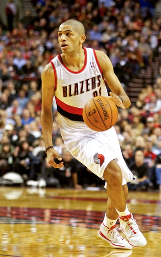 Nov 5, 2013; Portland, OR, USA; Portland Trail Blazers small forward Nicolas Batum (88) drives to the basket against the Houston Rockets at the Moda Center. Mandatory Credit: Craig Mitchelldyer-USA TODAY Sports
