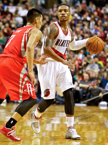 Nov 5, 2013; Portland, OR, USA; Portland Trail Blazers point guard Damian Lillard (0) brings the ball up court against the Houston Rockets at the Moda Center. Mandatory Credit: Craig Mitchelldyer-USA TODAY Sports