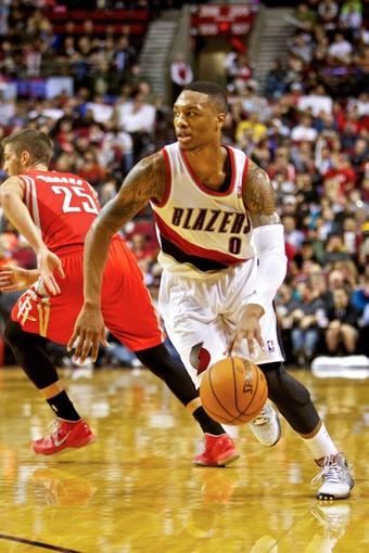 Nov 5, 2013; Portland, OR, USA; Portland Trail Blazers point guard Damian Lillard (0) drives to the basket against the Houston Rockets at the Moda Center. Mandatory Credit: Craig Mitchelldyer-USA TODAY Sports