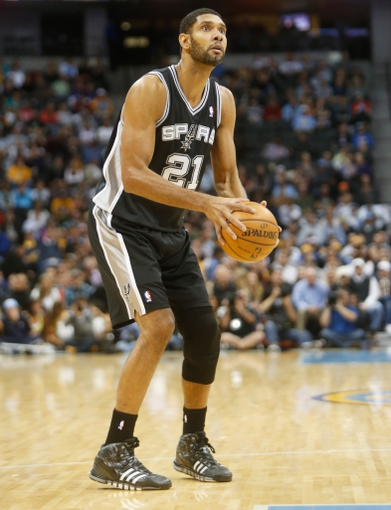 Nov 5, 2013; Denver, CO, USA; San Antonio Spurs forward Tim Duncan (21) prepares to shoot the ball during the second half against the Denver Nuggets at Pepsi Center. The Spurs won 102-94. Mandatory Credit: Chris Humphreys-USA TODAY Sports