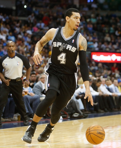Nov 5, 2013; Denver, CO, USA; San Antonio Spurs guard Danny Green (4) drives to the basket during the second half against the Denver Nuggets at Pepsi Center. The Spurs won 102-94. Mandatory Credit: Chris Humphreys-USA TODAY Sports