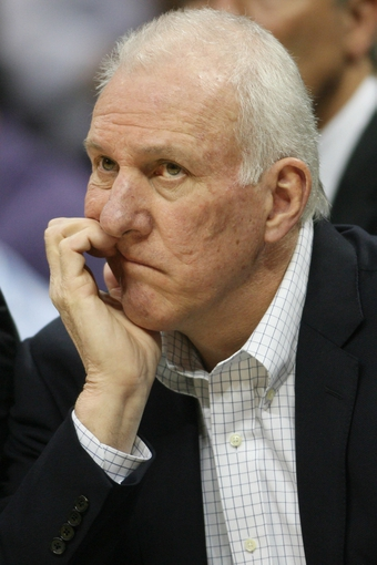 Nov 5, 2013; Denver, CO, USA; San Antonio Spurs coach Gregg Popovich watches from the bench during the first half against the Denver Nuggets at Pepsi Center. The Spurs won 102-94. Mandatory Credit: Chris Humphreys-USA TODAY Sports