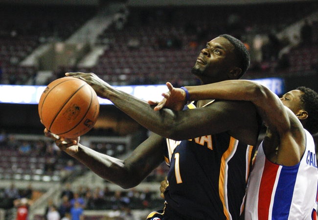 Nov 5, 2013; Auburn Hills, MI, USA; Indiana Pacers shooting guard Lance Stephenson (1) is fouled by Detroit Pistons shooting guard Kentavious Caldwell-Pope (5) during the fourth quarter at The Palace of Auburn Hills. The Pacers beat the Pistons 99-91. Mandatory Credit: Raj Mehta-USA TODAY Sports