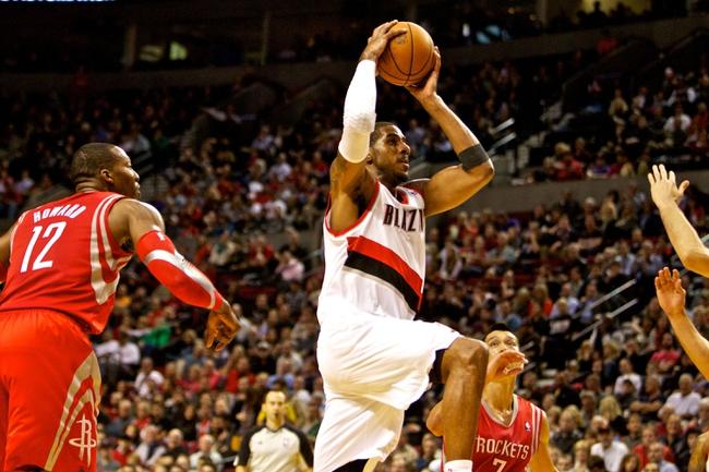 Nov 5, 2013; Portland, OR, USA; Portland Trail Blazers power forward LaMarcus Aldridge (12) drives to the basket past Houston Rockets center Dwight Howard (12)] at the Moda Center. Mandatory Credit: Craig Mitchelldyer-USA TODAY Sports