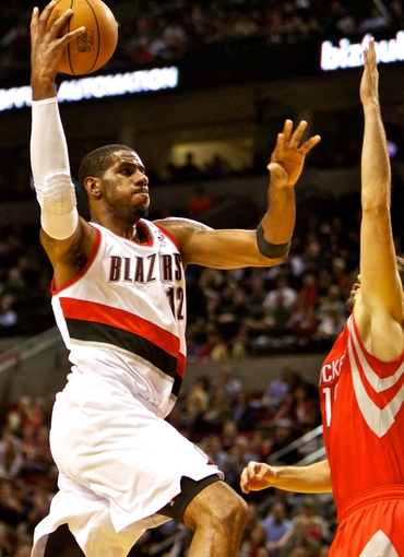 Nov 5, 2013; Portland, OR, USA; Portland Trail Blazers power forward LaMarcus Aldridge (12) shoots over Houston Rockets small forward Omri Casspi (18) at the Moda Center. Mandatory Credit: Craig Mitchelldyer-USA TODAY Sports