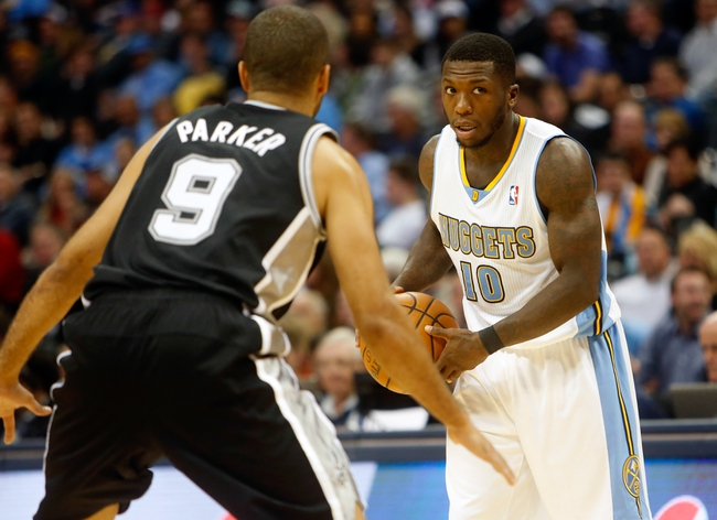 Nov 5, 2013; Denver, CO, USA; Denver Nuggets guard Nate Robinson (10) against San Antonio Spurs guard Tony Parker (9) during the first half against the San Antonio Spurs at Pepsi Center. Mandatory Credit: Chris Humphreys-USA TODAY Sports