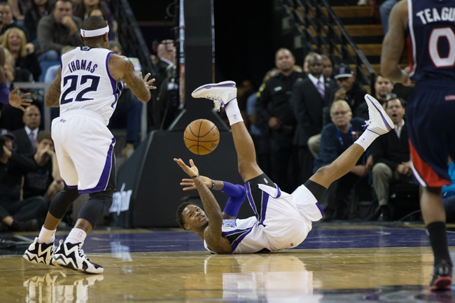 Nov 5, 2013; Sacramento, CA, USA; Sacramento Kings shooting guard Ben McLemore (16) passes the ball to point guard Isaiah Thomas (22) from the floor after stealing the by against the Atlanta Hawks during the fourth quarter at Sleep Train Arena. The Atlanta Hawks defeated the Sacramento Kings 105-100. Mandatory Credit: Kelley L Cox-USA TODAY Sports