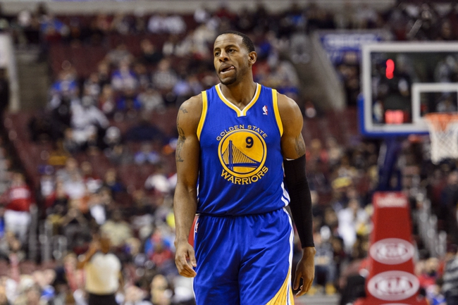 Nov 4, 2013; Philadelphia, PA, USA; Golden State Warriors guard Andre Iguodala (9) during the third quarter against the Philadelphia 76ers at Wells Fargo Center. The Warriors defeated the Sixers 110-90. Mandatory Credit: Howard Smith-USA TODAY Sports