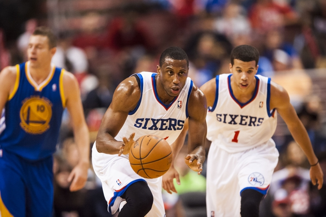 Nov 4, 2013; Philadelphia, PA, USA; Philadelphia 76ers forward Thaddeus Young (21) brings the ball up court during the third quarter against the Golden State Warriors at Wells Fargo Center. The Warriors defeated the Sixers 110-90. Mandatory Credit: Howard Smith-USA TODAY Sports