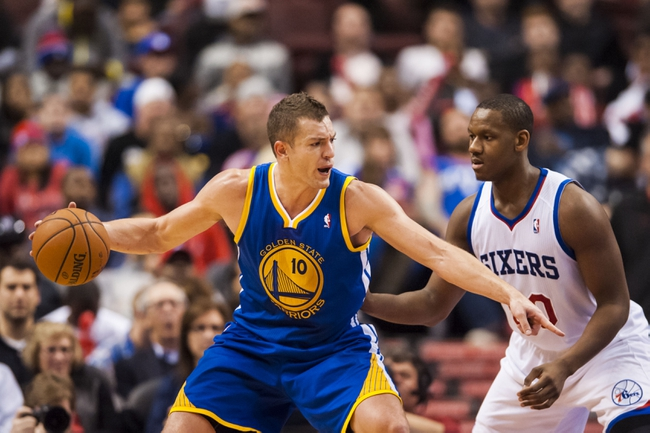 Nov 4, 2013; Philadelphia, PA, USA; Golden State Warriors forward David Lee (10) is defended by Philadelphia 76ers center Lavoy Allen (50) during the third quarter at Wells Fargo Center. The Warriors defeated the Sixers 110-90. Mandatory Credit: Howard Smith-USA TODAY Sports