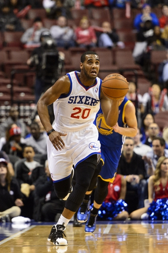 Nov 4, 2013; Philadelphia, PA, USA; Philadelphia 76ers forward Brandon Davies (20) brings the ball up court during the fourth quarter against the Golden State Warriors at Wells Fargo Center. The Warriors defeated the Sixers 110-90. Mandatory Credit: Howard Smith-USA TODAY Sports