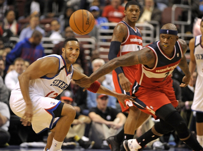 Nov 6, 2013; Philadelphia, PA, USA; Philadelphia 76ers small forward Evan Turner (12) and Washington Wizards power forward Al Harrington (7) go after loose ball during the first half at Wells Fargo Center. Mandatory Credit: Eric Hartline-USA TODAY Sports