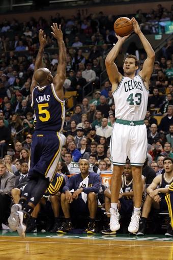 Nov 6, 2013; Boston, MA, USA; Boston Celtics power forward Kris Humphries (43) shoots against Utah Jazz point guard John Lucas III (5) in the first quarter at TD Garden. Mandatory Credit: David Butler II-USA TODAY Sports