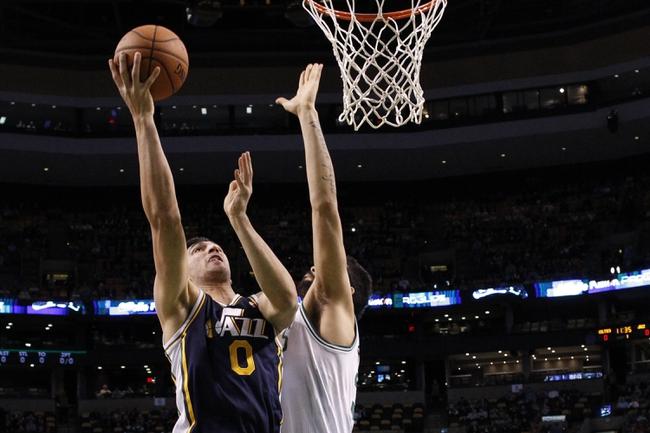 Nov 6, 2013; Boston, MA, USA; Utah Jazz center Enes Kanter (0) shoots against Boston Celtics center Vitor Faverani (38) in the first quarter at TD Garden. Mandatory Credit: David Butler II-USA TODAY Sports