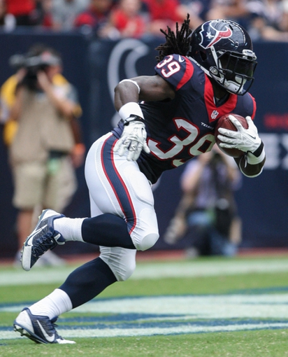 Aug 25, 2013; Houston, TX, USA; Houston Texans running back Deji Karim (39) returns a kick during the first quarter against the New Orleans Saints at Reliant Stadium. Mandatory Credit: Troy Taormina-USA TODAY Sports
