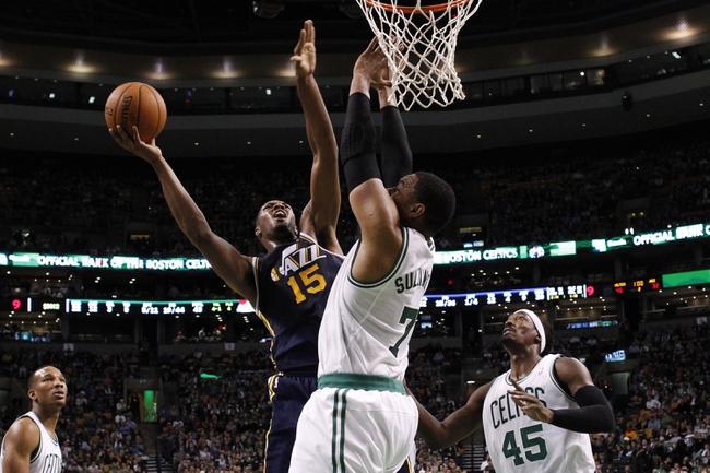 Nov 6, 2013; Boston, MA, USA; Utah Jazz power forward Derrick Favors (15) shoots against Boston Celtics power forward Jared Sullinger (7) in the first quarter at TD Garden. Mandatory Credit: David Butler II-USA TODAY Sports