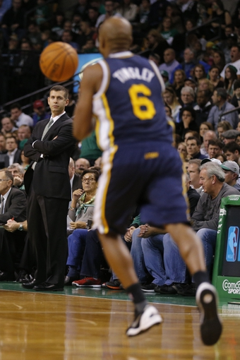 Nov 6, 2013; Boston, MA, USA; Boston Celtics head coach Brad Stevens watches from the sideline as Utah Jazz guard Jamaal Tinsley (6) controls the basketball in the first quarter at TD Garden. Mandatory Credit: David Butler II-USA TODAY Sports