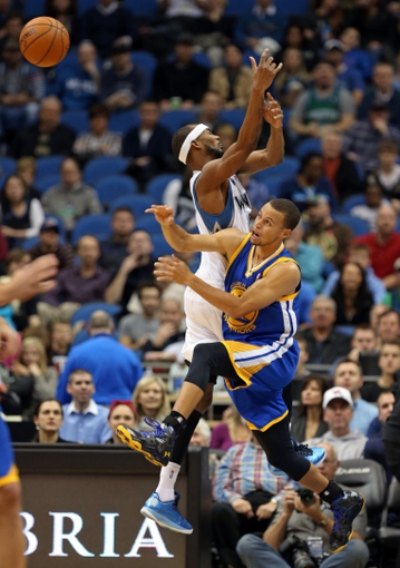 Nov 6, 2013; Minneapolis, MN, USA; Minnesota Timberwolves small forward Corey Brewer (13) and Golden State Warriors point guard Stephen Curry (30) fight for a loose ball in the first half at Target Center. Mandatory Credit: Jesse Johnson-USA TODAY Sports
