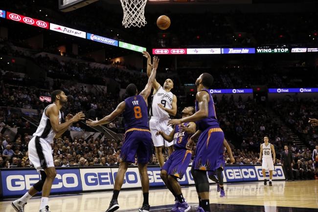 Nov 6, 2013; San Antonio, TX, USA; San Antonio Spurs guard Tony Parker (9) takes a shot over Phoenix Suns forward Channing Frye (8) during the first half at AT&T Center. Mandatory Credit: Soobum Im-USA TODAY Sports