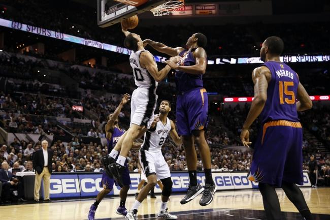 Nov 6, 2013; San Antonio, TX, USA; San Antonio Spurs guard Manu Ginobili (20) drives to the basket as Phoenix Suns forward Channing Frye (right) defends during the first half at AT&T Center. Mandatory Credit: Soobum Im-USA TODAY Sports