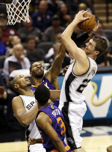 Nov 6, 2013; San Antonio, TX, USA; San Antonio Spurs forward Tiago Splitter (22) gets fouled while shooting against Phoenix Suns guard Ish Smith (3) during the first half at AT&T Center. Mandatory Credit: Soobum Im-USA TODAY Sports