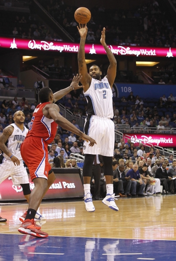 Nov 6, 2013; Orlando, FL, USA; Orlando Magic power forward Kyle O'Quinn (2) shoots over Los Angeles Clippers small forward Jared Dudley (9) during the second half at Amway Center. Orlando Magic defeated the Los Angeles Clippers 98-90. Mandatory Credit: Kim Klement-USA TODAY Sports