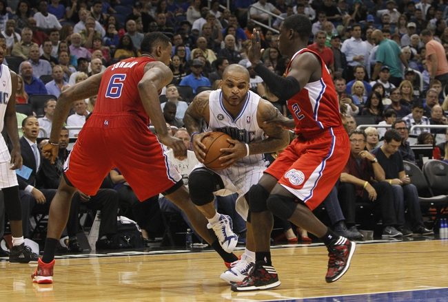 Nov 6, 2013; Orlando, FL, USA; Orlando Magic point guard Jameer Nelson (14) drives to the basket as Los Angeles Clippers center DeAndre Jordan (6) and point guard Darren Collison (2) defend during the second half at Amway Center. Orlando Magic defeated the Los Angeles Clippers 98-90. Mandatory Credit: Kim Klement-USA TODAY Sports