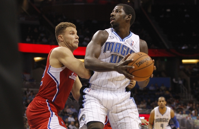 Nov 6, 2013; Orlando, FL, USA; Orlando Magic power forward Andrew Nicholson (44) drives to the basket as Los Angeles Clippers power forward Blake Griffin (32) defends during the second half at Amway Center. Orlando Magic defeated the Los Angeles Clippers 98-90. Mandatory Credit: Kim Klement-USA TODAY Sports