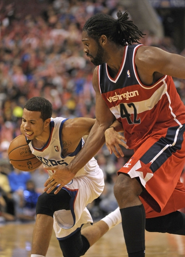 Nov 6, 2013; Philadelphia, PA, USA; Philadelphia 76ers point guard Michael Carter-Williams (1) tries to get past Washington Wizards power forward Nene Hilario (42) during the second half at Wells Fargo Center. The Wizards defeated the 76ers, 116-102. Mandatory Credit: Eric Hartline-USA TODAY Sports