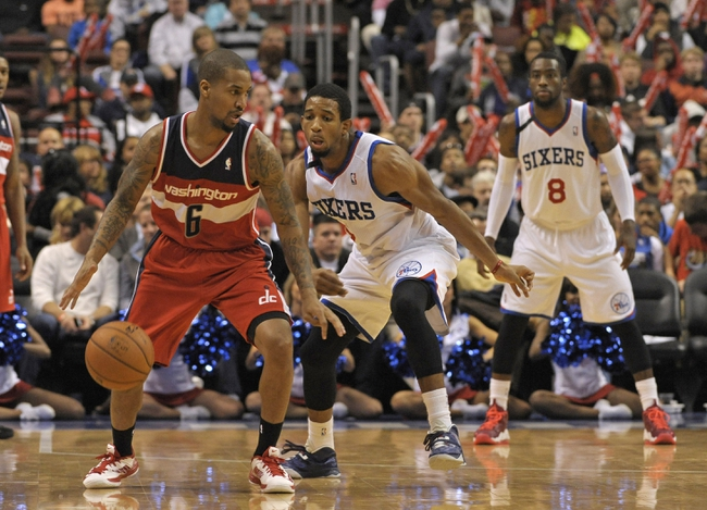 Nov 6, 2013; Philadelphia, PA, USA; Washington Wizards point guard Eric Maynor (6) runs a play against Philadelphia 76ers point guard Darius Morris (7) during the second half at Wells Fargo Center. The Wizards defeated the 76ers, 116-102. Mandatory Credit: Eric Hartline-USA TODAY Sports
