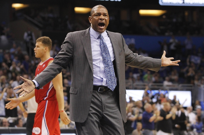Nov 6, 2013; Orlando, FL, USA; Los Angeles Clippers head coach Doc Rivers reacts against the Orlando Magic during the second half at Amway Center. Orlando Magic defeated the Los Angeles Clippers 98-90. Mandatory Credit: Kim Klement-USA TODAY Sports
