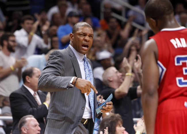Nov 6, 2013; Orlando, FL, USA; Los Angeles Clippers head coach Doc Rivers reacts against the Orlando Magic during the fourth quarter at Amway Center. Orlando Magic defeated the Los Angeles Clippers 98-90. Mandatory Credit: Kim Klement-USA TODAY Sports