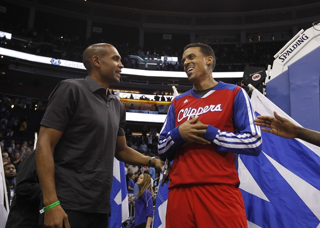 Nov 6, 2013; Orlando, FL, USA; American former basketball player Grant Hill (left) talks with Los Angeles Clippers small forward Matt Barnes (22) at the end of the game against the Orlando Magic at Amway Center. Orlando Magic defeated the Los Angeles Clippers 98-90. Mandatory Credit: Kim Klement-USA TODAY Sports