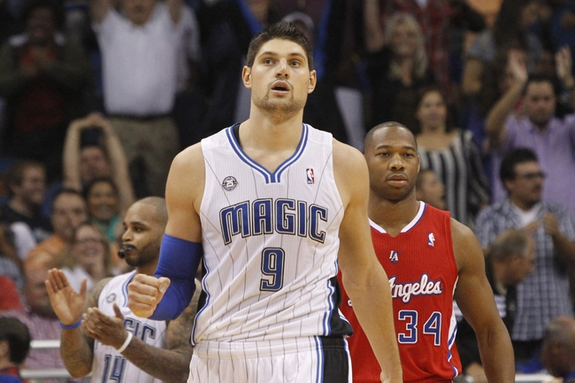 Nov 6, 2013; Orlando, FL, USA; Orlando Magic center Nikola Vucevic (9) pumps his fist against the Los Angeles Clippers during the second half at Amway Center. Orlando Magic defeated the Los Angeles Clippers 98-90. Mandatory Credit: Kim Klement-USA TODAY Sports