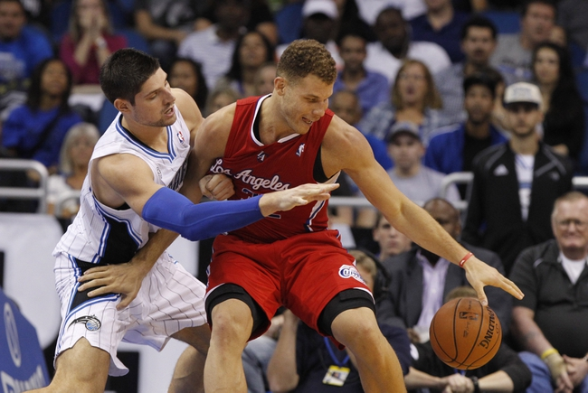 Nov 6, 2013; Orlando, FL, USA; Los Angeles Clippers power forward Blake Griffin (32) drives to the basket as Orlando Magic center Nikola Vucevic (9) defends during the second half at Amway Center. Orlando Magic defeated the Los Angeles Clippers 98-90. Mandatory Credit: Kim Klement-USA TODAY Sports