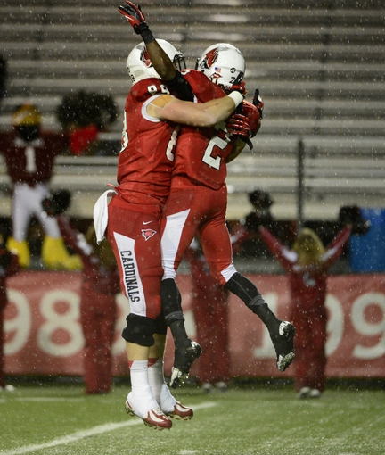 Nov 6, 2013; Muncie, IN, USA; Ball State Cardinals tight end Zane Fakes (88) and wide receiver Jamill Smith (2) celebrate a touchdown against the Central Michigan Chippewas at Scheumann  Stadium. Mandatory Credit: Marc Lebryk-USA TODAY Sports