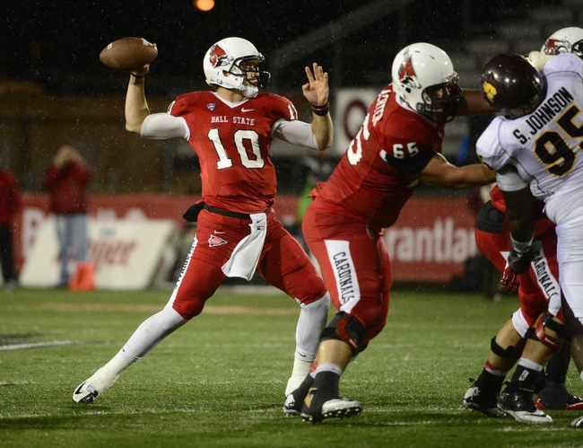 Nov 6, 2013; Muncie, IN, USA; Ball State Cardinals quarterback Keith Wenning (10) passes the ball against the Central Michigan Chippewas at Scheumann  Stadium. Mandatory Credit: Marc Lebryk-USA TODAY Sports